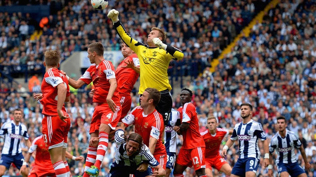 Artur Boruc punches clear in a congested Southampton box