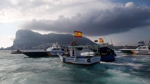 A Gibraltar police boat, Spanish Guardia Civil boat and Spanish fishing boats sail during a protest by Spanish fishermen in the sea near the Spain/Gibraltar border