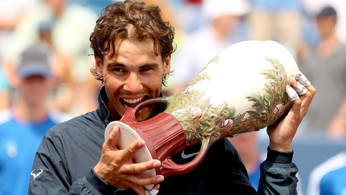 Rafael Nadal adopts his customary trophy ceremony pose with the  Rookwood Cup