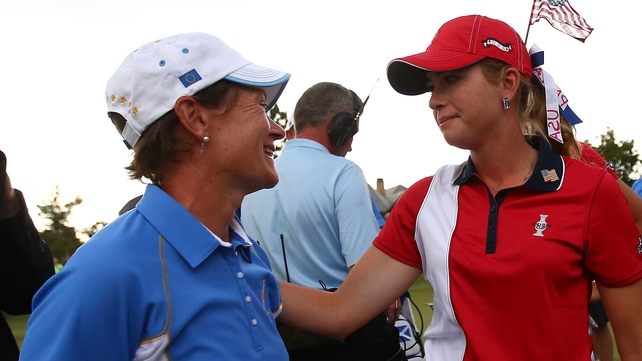 Paula Creamer of the United States (right) congratulates Catriona Matthew of Scotland (left)
