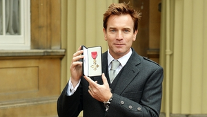 Ewan McGregor accepting an OBE at Buckingham Palace in June