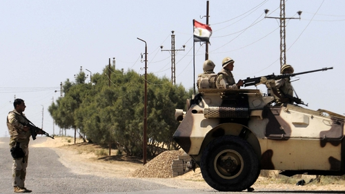 Egyptian soldiers stand guard in the area of the Rafah Crossing
