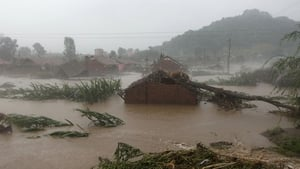 A house sits destroyed by flooding in Huadian in northeast China