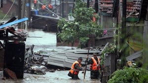 Rescuers search for victims of the floods in Huadian in northeast China