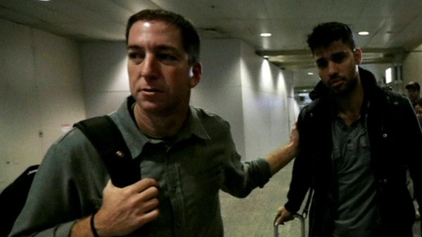 David Miranda (right) arriving in Rio de Janeiro airport with Glenn Greenwald (pic: The Guardian/Glenn Greenwald/Laura Poitras)