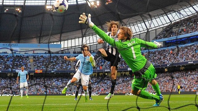 David Silva heads home the game's opening goal