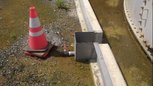 Contaminated water gathering beside a valve which is believed to have caused the leak
