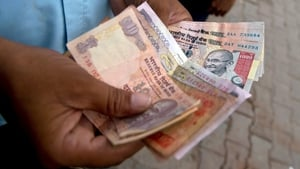 India's central bank steps in to half fall in country's currency, the rupee
