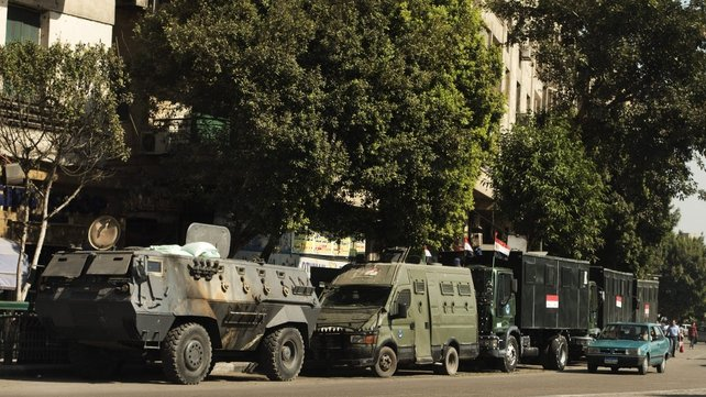 Egyptian riot police vehicles are parked in the main street leading to Cairo's landmark Tahrir square