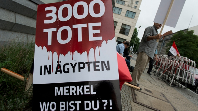 Pro-Mursi supporters protest outside the Egyptian Embassy in Berlin