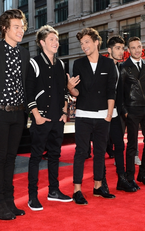 Simon Cowell has hinted that a One Direction TV show is in the works