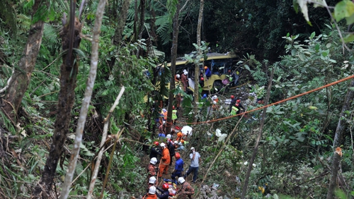 Rescuers take survivors from wreckage of bus crash