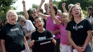 Supporters of Bradley Manning react after attending his sentencing hearing
