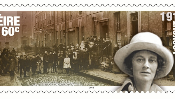 Stamp depicting Countess Markievicz outside tenement buildings