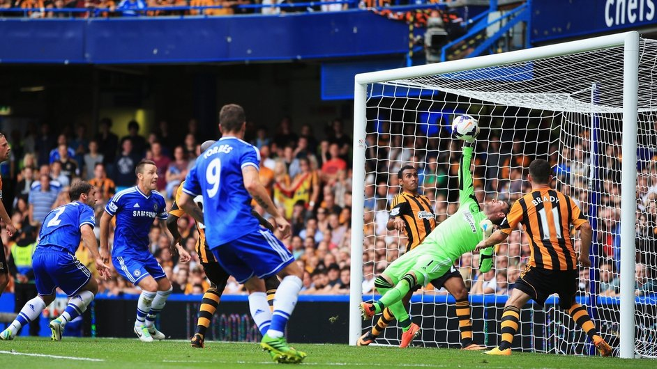 Goalkeeper Allan McGregor of Hull City makes a one-handed save on the line from Branislav Ivanovic of Chelsea