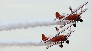 Nine-year-old English cousins Rose Powell and Flame Brewer become the world's youngest formation wingwalkers