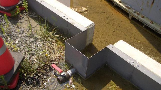 Leaked radioactive water remains near the tank at the Fukushima Daiichi Nuclear Power Plant
