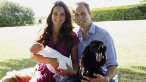 Prince William and his wife Kate show off their new son George in the grounds of Bucklebury Manor