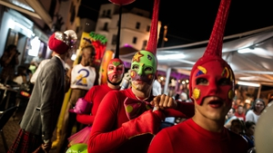 Go-Go dancers from Ibiza's main clubs walk on the streets at the Marina