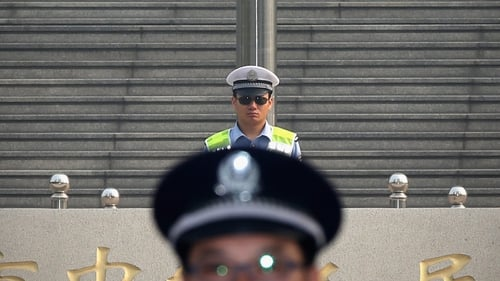 Policemen stand guard outside the court on the third day of former senior Chinese politician Bo Xilai's trial in Jinan.