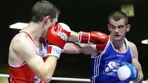 Adam Nolan (blue) will face Bernard Roe in a welterweight semi-final