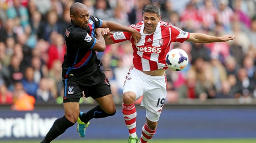 Danny Gabbidon (L) grapples with Jonathan Walters of Stoke