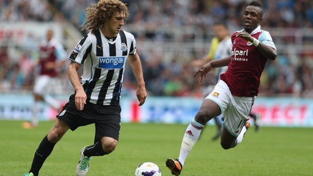 Newcastle's Fabricio Coloccini and Modibo Maiga of West Ham