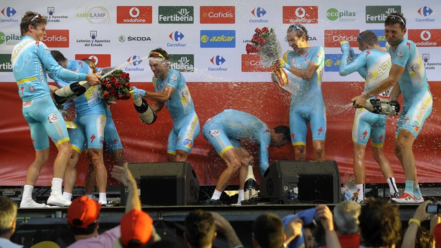 Astana Pro Team celebrates on the podium their victory