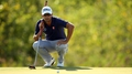 Scott hangs onto lead as Bradley looms