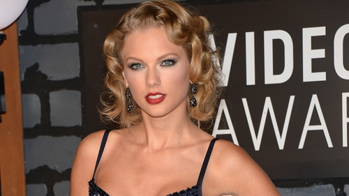 Taylor Swift stole the show in a Herve Leger by Max Azria gown