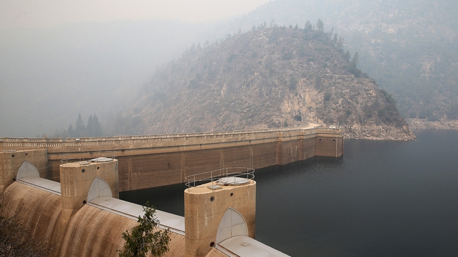 Smoke from the Rim Fire lingers over the O'Shaughnessy Dam at Hetch Hetchy Reservoir