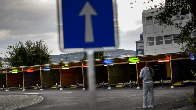 A prostitute faces 'sex boxes' at the opening day of Switzerland's first sex drive-in