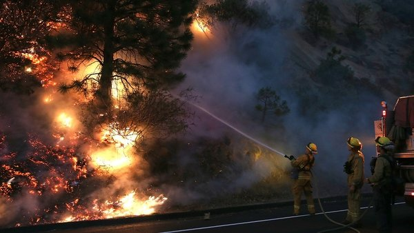 A firefighting force of around 3,700 personnel is tackling the sprawling blaze