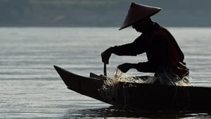 A fisherman on the Mekong river, proposed site of 11 hydroelectric dams
