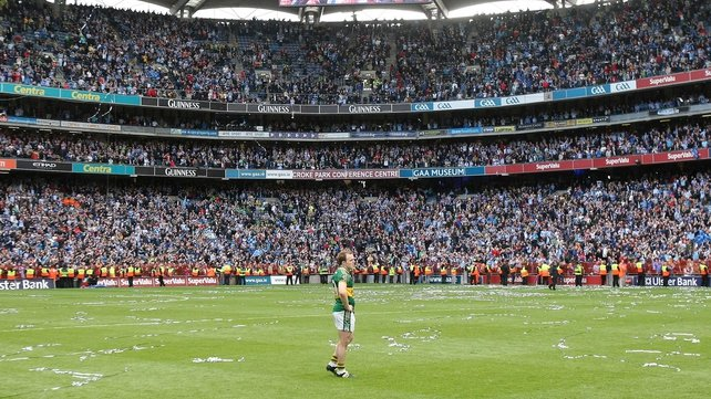 A dejected Darran O'Sullivan stands alone as Dublin lift Sam Maguire in 2011