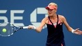 Na & Radwanska advance at stormy Flushing Meadows
