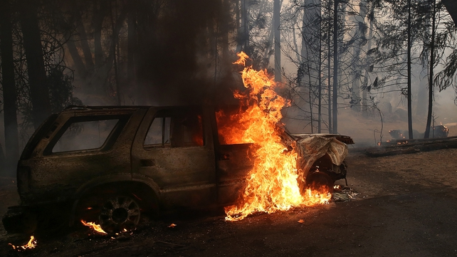 Flames billow from the front of a car  consumed by the Rim Fire on 25 August