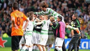 Glasgow Celtic players celebrate following the final whistle in their Champions League playoff