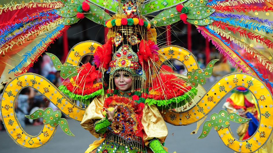 A model shows off her costume at the Jember Fashion Carnaval in Indonesia