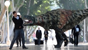 A commuter narrowly avoids a Tyrannosaurus Rex out on its morning stroll to promote an exhibit in Sydney