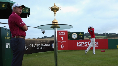 Espen Kofstad hits his opening tee shot under the watchful eye of Ryder Cup captain Paul McGinley