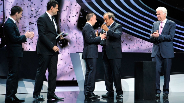 Franck Ribery was presented his award by UEFA president Michel Platini