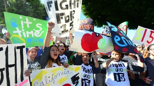 Fast food workers and supporters take part in a strike outside a McDonald's outlet in Los Angeles