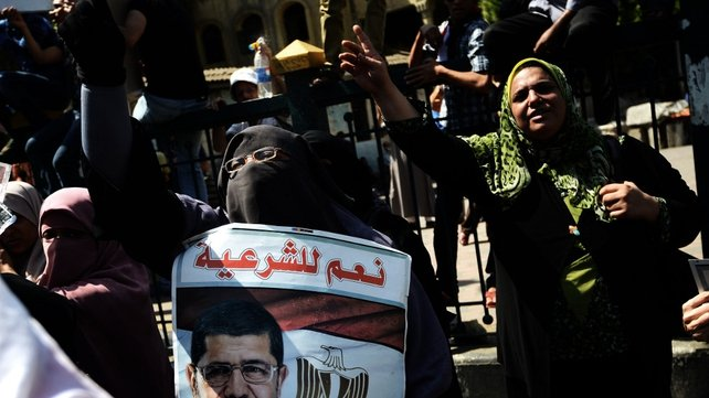 A woman chants slogans in support of Mohammed Mursi at a rally in Cairo