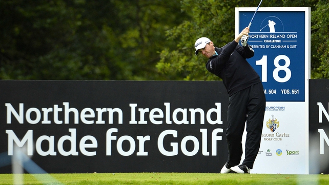 Michael Hoey tees off at the 18th hole at Galgorm Castle but will not be playing at the weekend after missing the cut