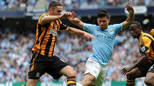 Sergio Aguero of Manchester City clashes with Ireland's Robbie Brady