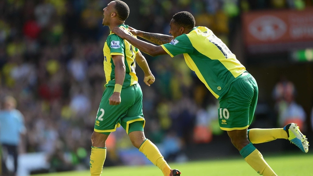 Nathan Redmond (l) celebrates his goal for the Canaries