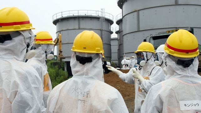 Japan's nuclear inspectors at water tanks early this month where radiation levels have rocketed in 'deplorable' situation