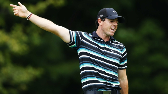 Rory McIlroy looks away in disgust as his drive did not go straight down the middle