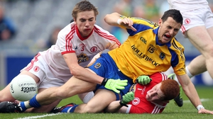 Diarmuid Murtagh of Roscommon, Rhys Quinn and goalkeeper Sean Fox of Tyrone clash during the MFC semi-final